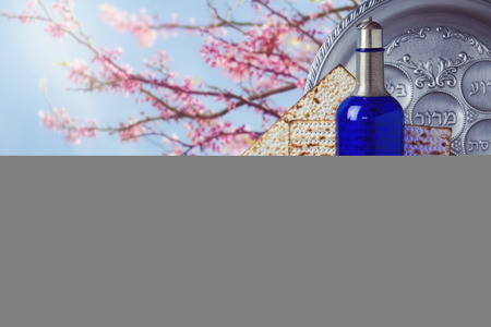 matzo: Passover matzo and wine on wooden vintage table over blossom tree background Stock Photo