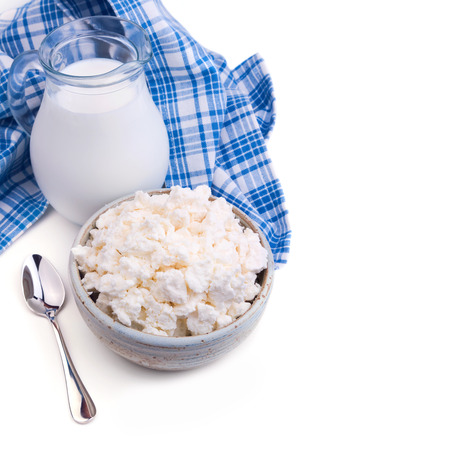 Milk and cottage cheese on white background photo