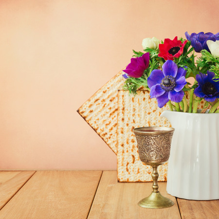 matzo: Passover background with matzo, wine and flowers on wooden table