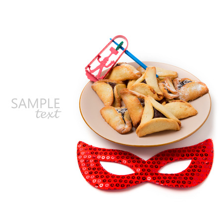 chocolate mask: Hamantaschen cookies on plate and carnival mask on white background