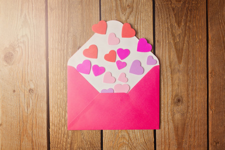 envelopes: Valentines day concept with envelope and heart shapes. Retro filter effect