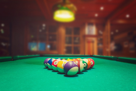 pool ball: Billiard balls on green pool table in bar or pub