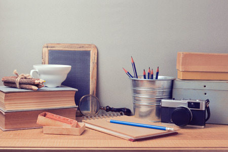 Retro artistic objects on wooden desk
