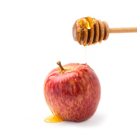 apple honey: Apple and honey on wooden stick for jewish new year celebration Stock Photo