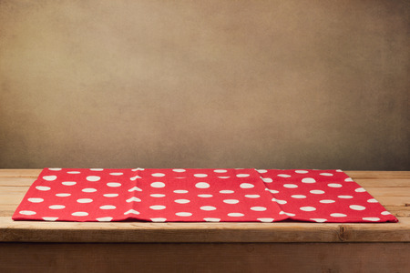 empty table: Empty wooden deck table with polka dots tablecloth Stock Photo