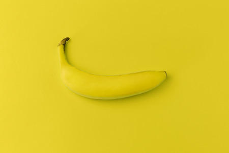 yelloow: Banana on yellow background