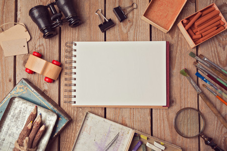 design objects: Notebook mock up for artwork or design presentation with creative objects. View from above