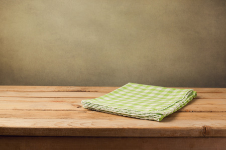tablecloth: Empty wooden table with checked green tablecloth Stock Photo