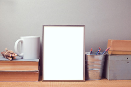 Picture frame mock up template with books and desk objects