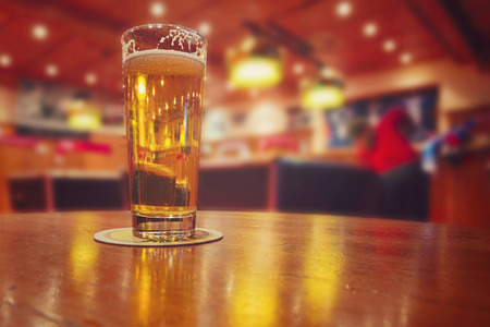 brewed: Beer glass  in bar with billiard tables