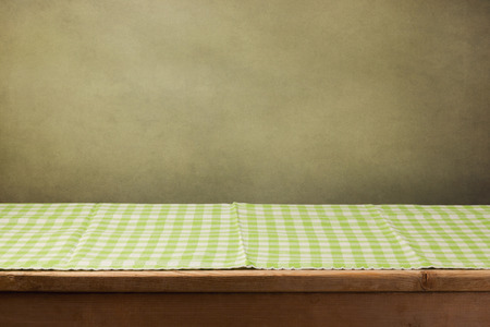 tablecloth: Wooden table with checked green tablecloth