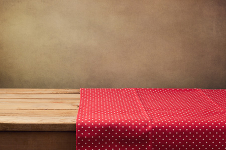 empty table: Empty wooden table with polka dots tablecloth