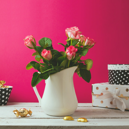 wood rose: Floral background with rose flower bouquet with chocolate.