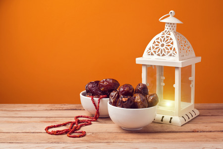 Dried date palm tree fruits with lantern Stock Photo