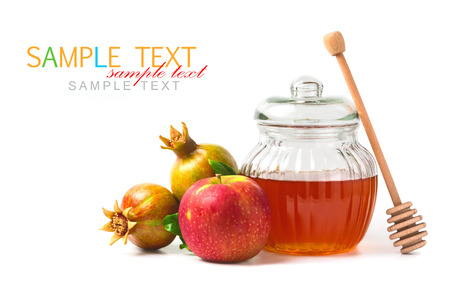 Honey jar and fresh apples with pomegranate on white background