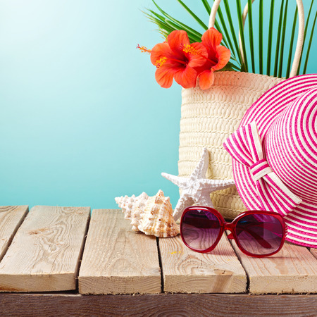 Beach accessories on wooden table