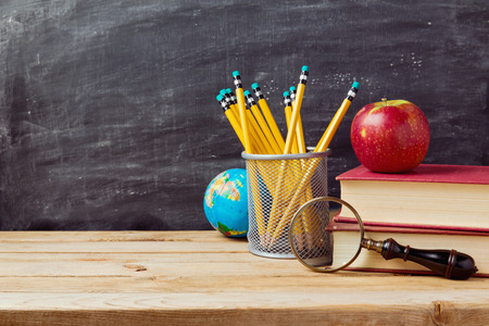 school table: Back to school background with teachers objects over chalkboard Stock Photo
