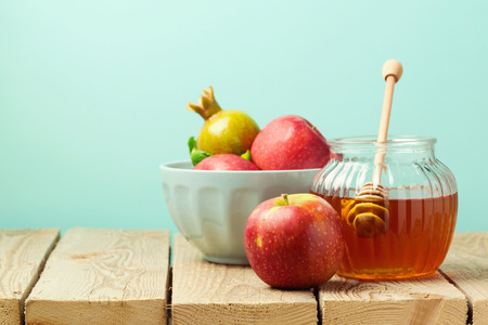 rosh: Apple and honey on wooden table over blue background Stock Photo