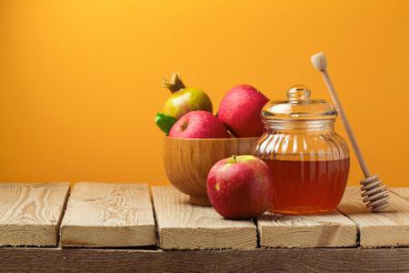rosh hashana: Jewish holiday Rosh Hashana (new year) celebration with honey jar and apples Stock Photo