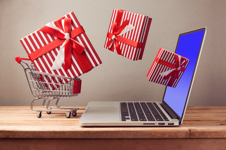 git: Shopping online concept with laptop computer and git box Stock Photo