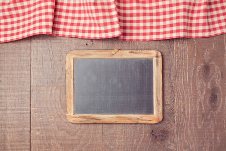 tablecloth: Abstract background with red checked tablecloth and chalkboard. View from above