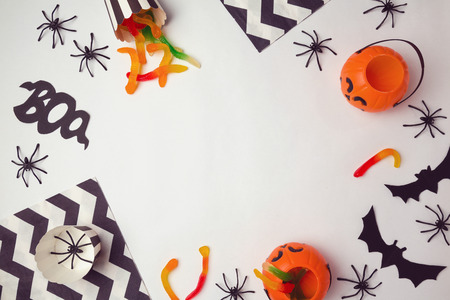 craft background: Halloween holiday background with spiders and candy. View from above