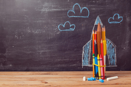 education: Back to school background with rocket made from pencils Stock Photo