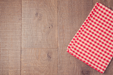 Abstract wooden texture background with red checked tablecloth. View from above Stock Photo