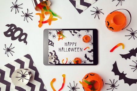 digital background: Halloween holiday background with digital tablet and decorations Stock Photo