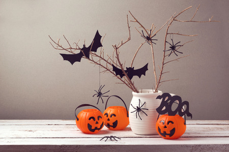 wood spider: Halloween holiday celebration with spiders and pumpkin buckets for trick or treat.