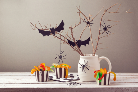 wood spider: Halloween party decorations with spiders and candy Stock Photo