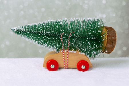 christmas toys: Christmas holiday concept with pine tree on toy car