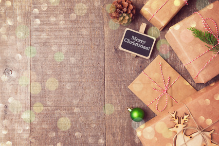 christmas cover: Christmas gifts on wooden background. View from above with copy space Stock Photo