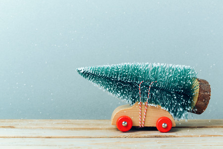 retro christmas: Christmas tree on toy car. Christmas holiday celebration concept