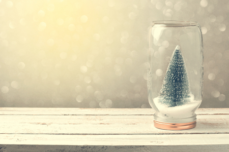 Christmas background with tree in jar and bokeh