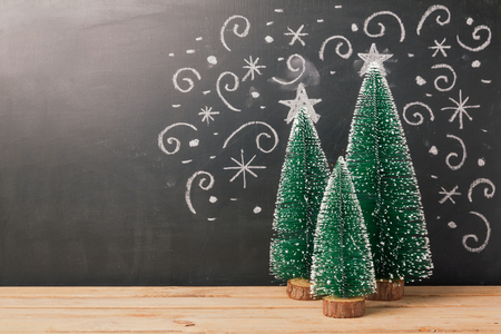 Christmas background with pine tree over chalkboard drawing