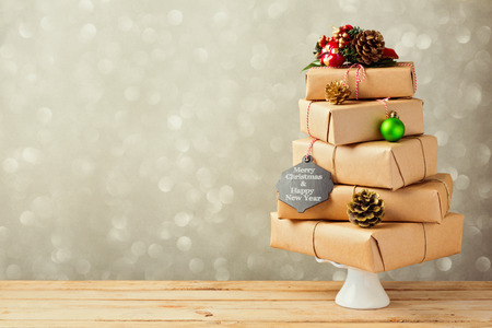the celebration of christmas: Christmas tree made from gft boxes. Alternative Christmas tree Stock Photo
