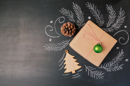 wrappings: Christmas holiday gift on chalkboard background. View from above with copy space Stock Photo