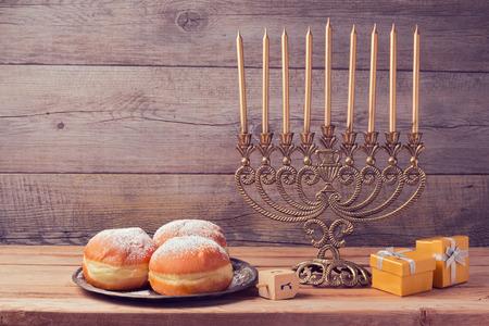 menorah: Jewish holiday hanukkah celebration with vintage menorah over wooden background