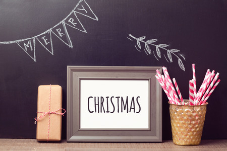xmas tree: Christmas poster mock up template over chalkboard background