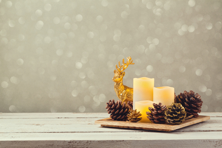 Christmas decorations with candles and pine corn Stock Photo