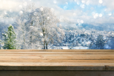 holiday display: Background with wooden table over winter lanscape