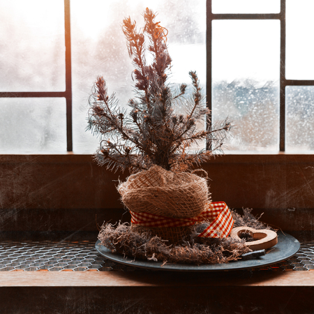 Rustic Christmas decoration over window. Retro filter effect Stock Photo