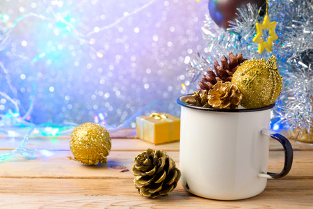 enamel: Rustic enamel cup with Christmas decorations over beautiful bokeh background