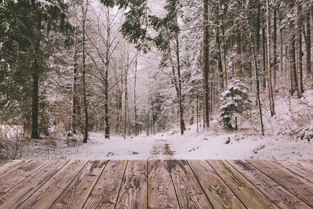 winter wood: Winter background with wooden terrace and nature forest landscape. Christmas holiday concept