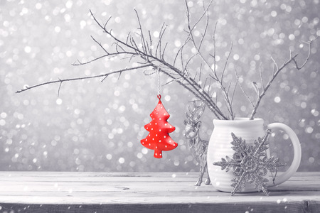silver ribbon: Christmas tree ornament hanging over bokeh background Stock Photo