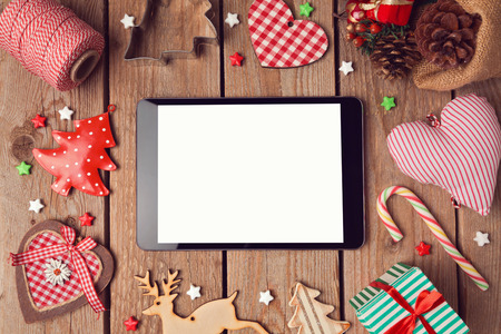 Digital tablet mock up with rustic Christmas decorations for app presentation