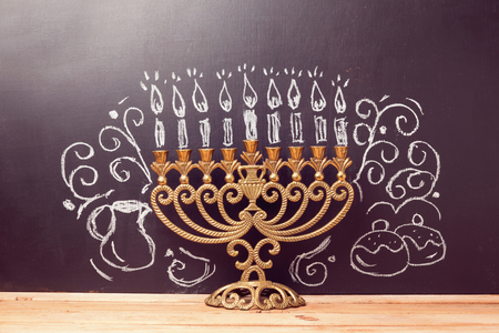 chanukah: Creative Jewish holiday Hanukkah background with menorahl over chalkboard with hand drawing