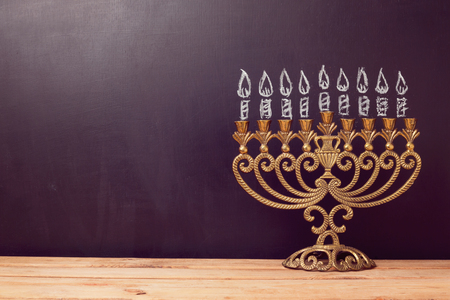 hanukkah: Jewish holiday Hanukkah background with menorah over chalkboard with hand drawing Stock Photo