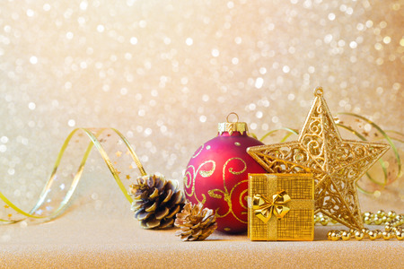 christmas gold: Christmas decorations in red and gold over glitter sparkle background